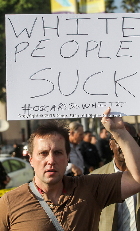 A demonstrator holds a sign during a rally and march circle to protest the all-white slate of Oscar acting nominees and calling for more diversity in the entertainment industry, Sunday Feb. 28, 2016 in Los Angeles.(Photo by Ringo Chiu/PHOTOFORMULA.com)<br /> <br /> Usage Notes: This content is intended for editorial use only. For other uses, additional clearances may be required.