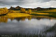 Light rain begins to fall on pond in the Chalk Buttes near Ekalaka, Montana, USA