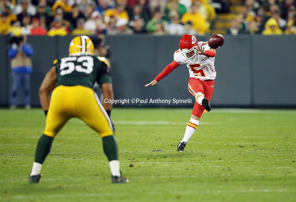Kansas City Chiefs kicker Cairo Santos (5) kicks off during the 2015 NFL week 3 regular season football game against the Green Bay Packers on Monday, Sept. 28, 2015 in Green Bay, Wis. The Packers won the game 38-28. (©Paul Anthony Spinelli)