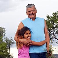 Zuni artist Jimmy Yawakia and his daughter Julie Yawakia, 9, at their home in Zuni Wednesday.