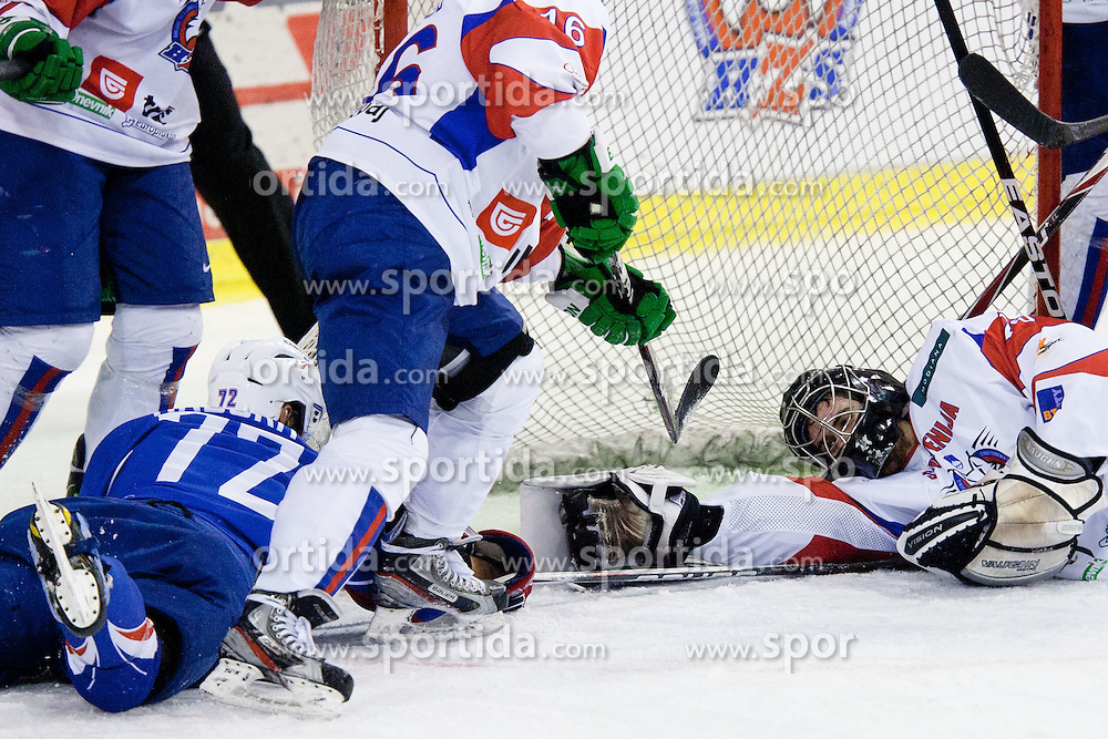 Robin Gaborit of France vs Gasper Kroselj of Slovenia during ice-hockey match between Slovenia and France in Slovenia Euro ice hockey challenge, on December 17, 2011 at Hala Tivoli, Ljubljana, Slovenia. France defeated Slovenia 6:5 after penalty shots. (Photo By Matic Klansek Velej / Sportida)
