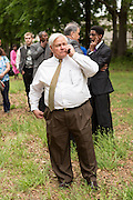 North Charleston Mayor Keith Summey waits for a peace vigil lead by Rev. Al Sharpton to begin on the spot where unarmed motorist Walter Scott was gunned down by police April 12, 2015 in North Charleston, South Carolina. About 100 people showed up for the brief vigil following a healing service at Charity Mission Baptist Church.