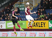 Mark Beevers  of Peterborough United and Chris Wood of Burnley jump for the ball during the The FA Cup match between Burnley and Peterborough United at Turf Moor, Burnley, England on 4 January 2020.