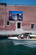 VENICE, ITALY..June 1997..47th Biennale of Venice.Art along a canale..(Photo by Heimo Aga)