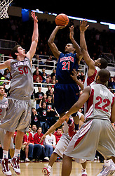 February 27, 2010; Stanford, CA, USA;  Arizona Wildcats guard Kyle Fogg (21) shoots over Stanford Cardinal forward Jack Trotter (50) during the first half at Maples Pavilion.  Arizona defeated Stanford 71-69.