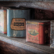 Old tins on a cabin shelf