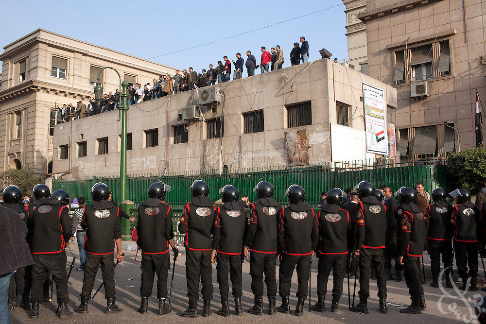 Egyptian riot police surround protesters atop the Lawyer's union building during continuing January 26, 2011 demonstrations in downtown Cairo, Egypt. A series of unprecedented demonstrations have broken out across Egypt for the past two days, inspired by the revolution in Tunisia, and intended to spark a similar movement in Egypt. (Photo by Scott Nelson)