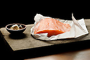 Side of Salmon with Bowl of Garlic and Salt