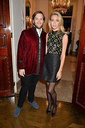 JOSEPH & SABINE GETTY at a party to kick off London Fashion Week hosted by US Ambassador Matthew Barzun and Mrs Brooke Brown Barzun with Alexandra Shulman in association with J.Crew hrld at Winfield House, Regent's Park, London on 18th September 2015.