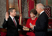 Nov 29, 2010 - Washington, District of Columbia, U.S. - JUDY KIRK holds the bible as Vice President BIDEN swears in her son, Sen.-Elect MARK KIRK, (R-IL) on Monday, during a re-enactment of the swearing-in at the Old Senate Chamber in the U.S. Capitol..(Credit Image: © Pete Marovich/ZUMA Press)