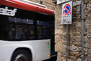 Italian ATAF bus service passes close medieval wall in side street near Ponte Vecchio in Florence.