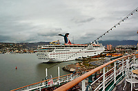 """(Image seven of eight). Panorama of the Ensenada harbor in Mexico on a grey and raining day from the deck of the MV World Odyssey. The other cruse ship is the Carnival Imagination. Once all of the students, faculty, staff, and life long learners were aboard we would be ready to begin the 102 day """"round the world"""" Semester at Sea Spring 2016 Voyage. Composite of eight images taken with a Nikon N1 V3 camera and 10-30 mm lens (ISO 200, 10 mm, f/11, 1/250 sec). Panorama stitched using AutoPano Giga Pro."""