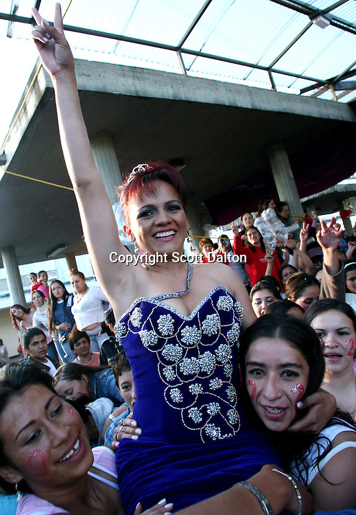 Angie Sanchez, 21-years-old, an inmate from cellblock 2 serving time for conspiracy to commit a crime, celebrates after winning the prison beauty pageant at the Good Shepard Prison, a female prison, in Bogotá, Colombia on Friday, September 21, 2007. Each September, the female inmates of the Good Shepherd Prison hold a beauty pageant in honor of the Virgin of Mercedes, the patron saint of prisoners. This year is the first year that the prison held two beauty contests, one for elderly inmates and another for the regular aged inmates. (Photo/Scott Dalton).