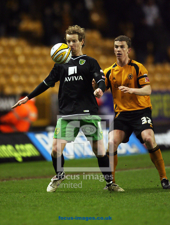 Wolverhampton - Tuesday February 3rd, 2009: Kevin Foley of Wolverhampton Wanderers and David Carney of Norwich City during the Coca Cola Championship match at Molineaux, Wolverhampton. (Pic by Chris Ratcliffe/Focus Images)