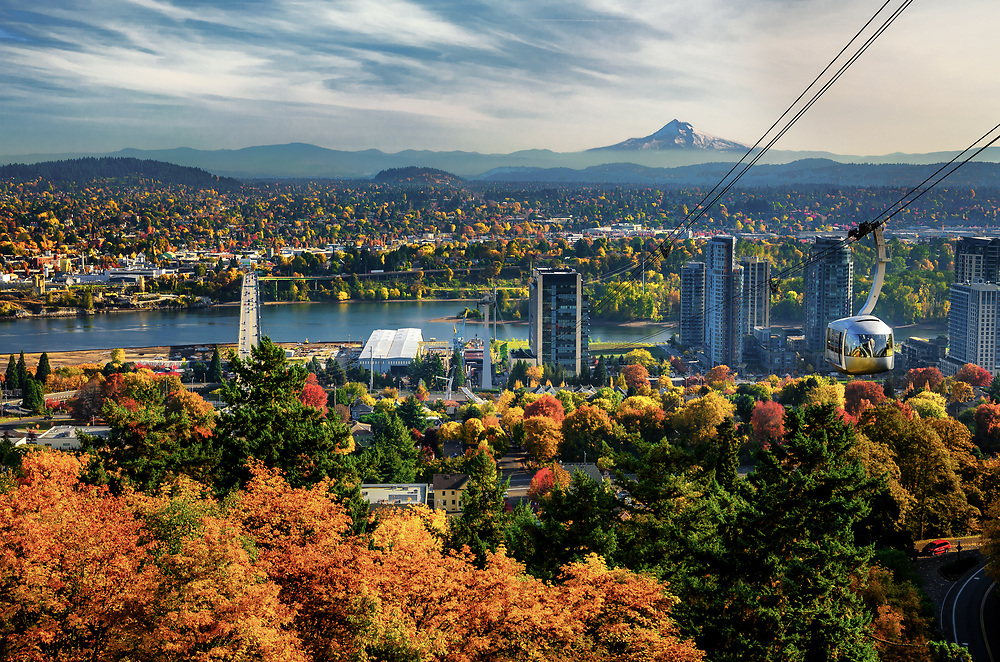 View of Portland skyline. Portland Aerial Tram and Mt. Hood on the background.