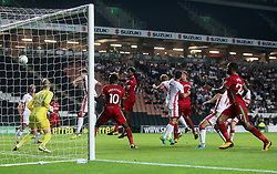 Swansea City's Leroy Fer (centre) scores their second goal during the Carabao Cup, Second Round match at Stadium MK, Milton Keynes.
