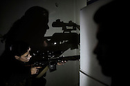 "SYRIA, ALEPPO. A Kurdish female fighter from the ""Popular Protection Units"" (YPG) aims at Syrian government forces inside a building in the majority-Kurdish Sheikh Maqsud district of the northern Syrian city of Aleppo. ALESSIO ROMENZI"