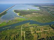 Nederland, Flevoland, Almere-Lelystad, 26-08-2019; begin van het natuurgebied de Oostvaardersplassen, met onder andere de gebieden Sompen en Kreekpunt en het water de Vinger. ZIcht op de Grote Plas, links de Oostvaardersdijk.  Natura 2000-gebied, in beheer bij Staatsbosbeer, onderdeel van Nationaal Park Nieuw Land. <br /> Beginning of the Oostvaardersplassen area.<br /> luchtfoto (toeslag op standard tarieven);<br /> aerial photo (additional fee required);<br /> copyright foto/photo Siebe Swart