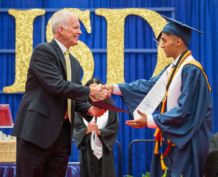 Graduation ceremonies for first class of Jane Long Academy at Butler Fieldhouse, May 27, 2016