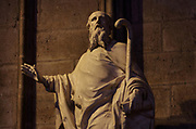 Statue of St Denis preaching, 1722, by Nicolas Coustou, 1658-1733, commissioned by Louis-Antoine de Noailles, archbishop of Paris 1695-1729, in the North transept of the Cathedrale Notre-Dame de Paris, or Notre-Dame cathedral, built 1163-1345 in French Gothic style, on the Ile de la Cite in the 4th arrondissement of Paris, France. St Denis was the first bishop of Paris and patron saint of Paris. The statue was commissioned for the altar of the St Denis chapel. Picture by Manuel Cohen