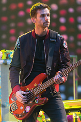 © Licensed to London News Pictures. 15/06/2016.  Coldplay member GUY BERRYMAN plays at Wembley Stadium during their Handful of Dreams World tour.<br /> <br /> Please note this supplied photo is for editorial usage only and cannot be used for merchandise.  This supplied photo must be deleted and withdraw from usage on 14th September 2016 as agreed by Coldplay management.  London, UK. Photo credit: Ray Tang/LNP