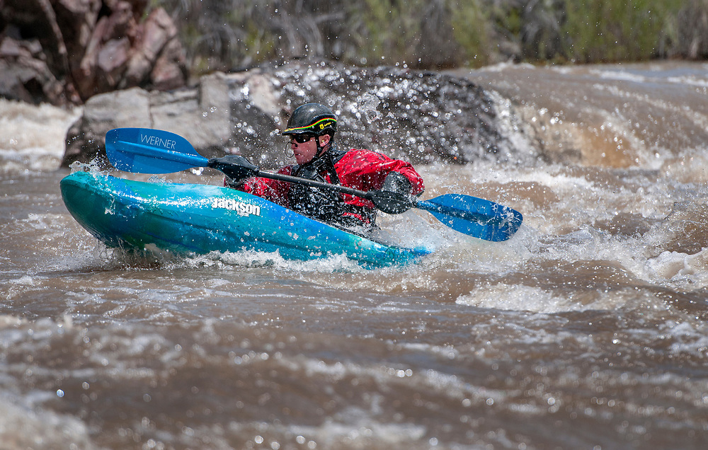 em051617e/jnorth/William Van Herpe, with the Santa Fe County Fire Department, kayaks through the Big Rock Rapid on the Rio Grande Racecource on his 42'd birthday, Tuesday May 16, 2017. The river is running at over 3100 cubic feet per second, almost twice its average.  (Eddie Moore/Albuquerque Journal