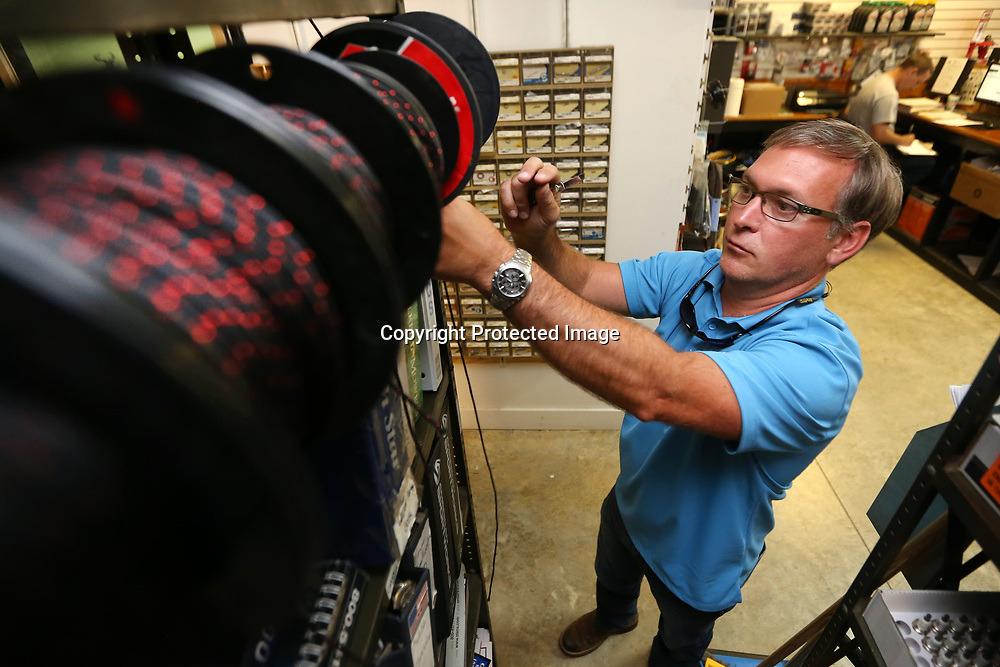 Ray Hopkins, owner of Turf Pros, cuts some recoil rope from his stock. Ray and his wife Ann purchased Turf Pros in December of 2016 and stress the inportance of service, carrying quality equipment and building great relationships with new and existing customers.