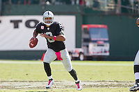 02 October 2011: Quarterback (8) Jason Campbell of the Oakland Raiders runs twith the football against the New England Patriots during the first half of the Patriots 31-19 victory against the Raiders in an NFL football game at O.co Stadium in Oakland, CA.