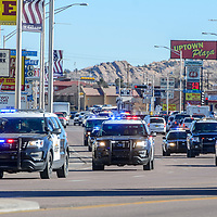 Gallup Police, McKinley County Sheriff and New Mexico State Police join in a memorial procession for Gallup Police Detective Donald Howard Ret. down Historic Highway 66 in Gallup Friday.  Howard died Dec. 18 after a battle with brain cancer.
