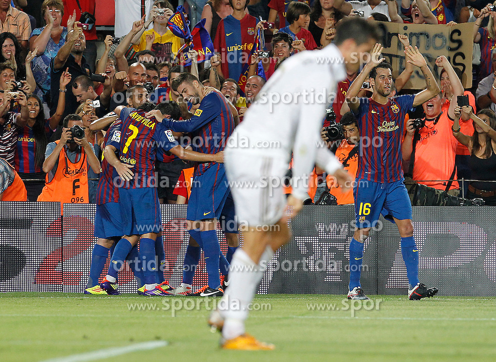 17.08.2011, Camp Nou, Barcelona, ESP, Supercup 2011, FC Barcelona vs Real Madrid, im Bild FC Barcelona's players celebrates goal in presence of Real Madrid's Cristiano Ronaldo (c) dejected during Spanish Supercup 2nd match.August 17,2011. EXPA Pictures © 2011, PhotoCredit: EXPA/ Alterphotos/ Acero +++++ ATTENTION - OUT OF SPAIN / ESP +++++