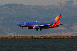 Boeing 737-7H4 (N216WR) operated by Southwest Airlines landing at San Francisco International Airport (KSFO), San Francisco, California, United States of America