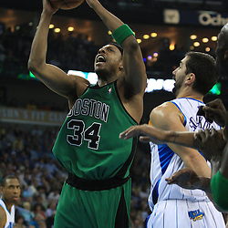 11 February 2009: Boston Celtics forward Paul Pierce (34) shoots over New Orleans Hornets forward Peja Stojakovic (16) during a NBA game between the Boston Celtics and the New Orleans Hornets at the New Orleans Arena in New Orleans, LA.