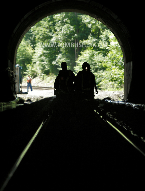 Workers walk into the Otisville Tunnel on Thursday, June 20, 2013. MTA Metro-North Railroad is repairing the rock section  of the mile-long tunnel.