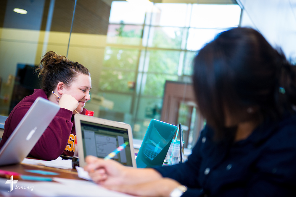 Kristina Janu (left) works in her math study group at Concordia University, Saint Paul, on Tuesday, August 5, 2014, in St. Paul, Minn. She is joined by Kayla Conrad (left).  LCMS Communications/Erik M. Lunsford