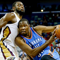 Dec 2, 2014; New Orleans, LA, USA; Oklahoma City Thunder forward Kevin Durant (35) drives past New Orleans Pelicans forward Tyreke Evans (1) during the second half of a game at the Smoothie King Center. The Pelicans defeated the Thunder 112-104. Mandatory Credit: Derick E. Hingle-USA TODAY Sports