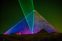 The Pyramid of Khufu (Cheops) at Giza (outside Cairo), Egypt illuminated by a laser.