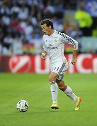 Real Madrid's Gareth Bale crosses for Real Madrid's Cristiano Ronaldo to score - Photo mandatory by-line: Joe Meredith/JMP - Mobile: 07966 386802 12/08/2014 - SPORT - FOOTBALL - Cardiff - Cardiff City Stadium - Real Madrid v Sevilla - UEFA Super Cup