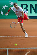 Mariusz Fyrstenberg of Poland in action while men's double during the BNP Paribas Davis Cup 2013 between Poland and Australia at Torwar Hall in Warsaw on September 14, 2013.<br /> <br /> Poland, Warsaw, September 14, 2013<br /> <br /> Picture also available in RAW (NEF) or TIFF format on special request.<br /> <br /> For editorial use only. Any commercial or promotional use requires permission.<br /> <br /> Photo by © Adam Nurkiewicz / Mediasport