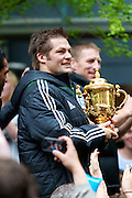 Richie McCaw of the New Zealand All Blacks, the 2011 Rugby World Cup champions, parade through the streets of Wellington with the Webb Ellis Cup. Rain and strong wind wasn't enough to deter Wellington locals from welcoming their heroes.