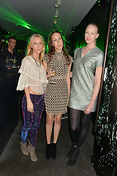 Left to right, MARY CHARTERIS, IRIS VAN HERPEN and JADE PARFITT at a reception to celebrate Dom Perignon and Iris van Herpen's collaboration 'Metamorphosis' held at the Hus Gallery, 10 Hanover Street, London on 27th October 2014.