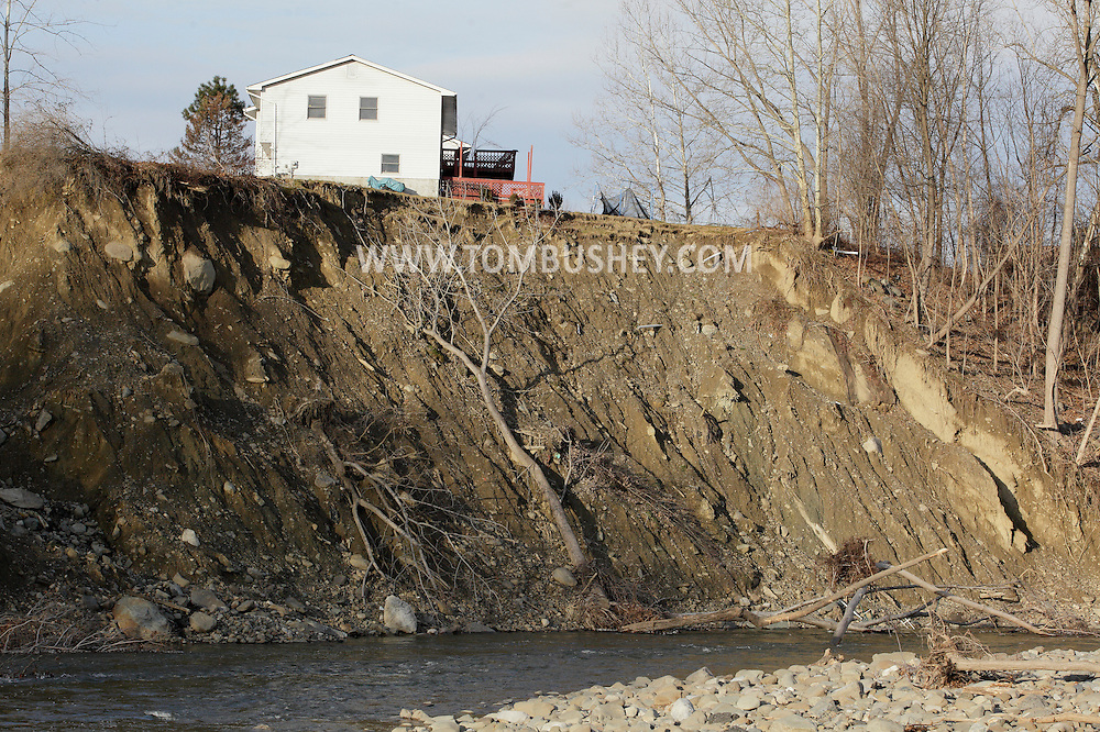 New Windsor, New York  - Water from the Moodna Creek eroded the hillside near this house on Butternut Drive during tropical storm Irene on Aug. 29, 2011. The house at the top of the bank was condemned. The photograph was taken on Dec. 29, 2011.