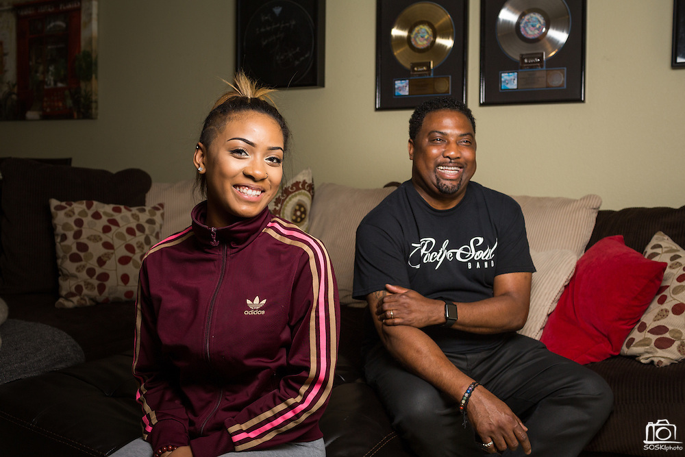 Saxophonist Eddie Mininfield and his daughter Jaci pose for a portrait at their home in Milpitas, California, on May 26, 2016. Mininfield's daughter is graduating from Milpitas High School this Spring and is the vocalist in a 10-piece band, Pacific Soul. (Stan Olszewski/SOSKIphoto)