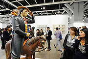 HONG KONG - MARCH 13:  Visitors look at sculpture 'Buster Keaton' by Jeff Koons on the preview day of Art Basel art fair on March 13, 2015 in Hong Kong, Hong Kong.  (Photo by Lucas Schifres/Getty Images)
