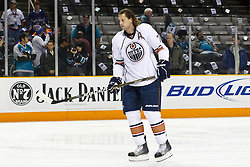 January 13, 2011; San Jose, CA, USA; Edmonton Oilers defenseman Tom Gilbert (77) warms up before the game against the San Jose Sharks at HP Pavilion.  Edmonton defeated San Jose 5-2. Mandatory Credit: Jason O. Watson / US PRESSWIRE