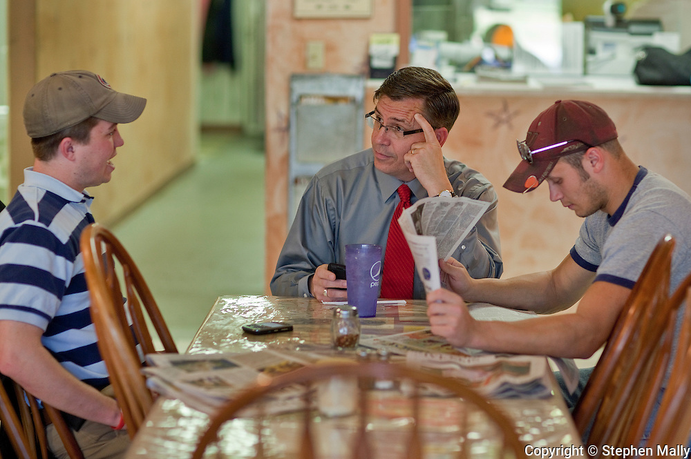 Congressman-elect Robert Schilling (center) (IL-17) talks with his son and campaign manager Terry Schilling (left) and campaign financial director Hank Belshause (right) at his pizza shop, Saint Giuseppe's Heavenly Pizza, in Moline, Illinois on Tuesday November 9, 2010.