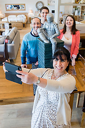 Oak Furniture Land Rotherham Store and Cake Artist Rose Dummer teakes a team selfie after enjoying a Celebration Breakfast with Man of Steel at the opening of the Oak Furniture Land Rotherham Store. The cake will be donated to Rotherham Hospice who will use it to help raise funds<br />