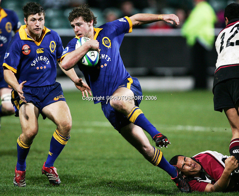 Otago first five Nick Evans slips a tackle during the Air New Zealand Cup pre season game between QBE Insurance North Harbour and Speight's Otago held at North Harbour Stadium in Auckland, New Zealand on Friday 14 July 2006. Photo: Tim Hales/PHOTOSPORT
