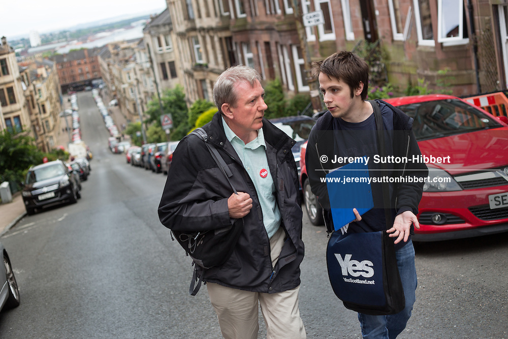 Graeme Sneddon (wearing Yes Scotland bag) and Ronnie….Pro-Independence 'Yes Scotland' canvassers and supporters out leafletting in Partick district, Glasgow, Scotland, Thursday 26th June 2014.