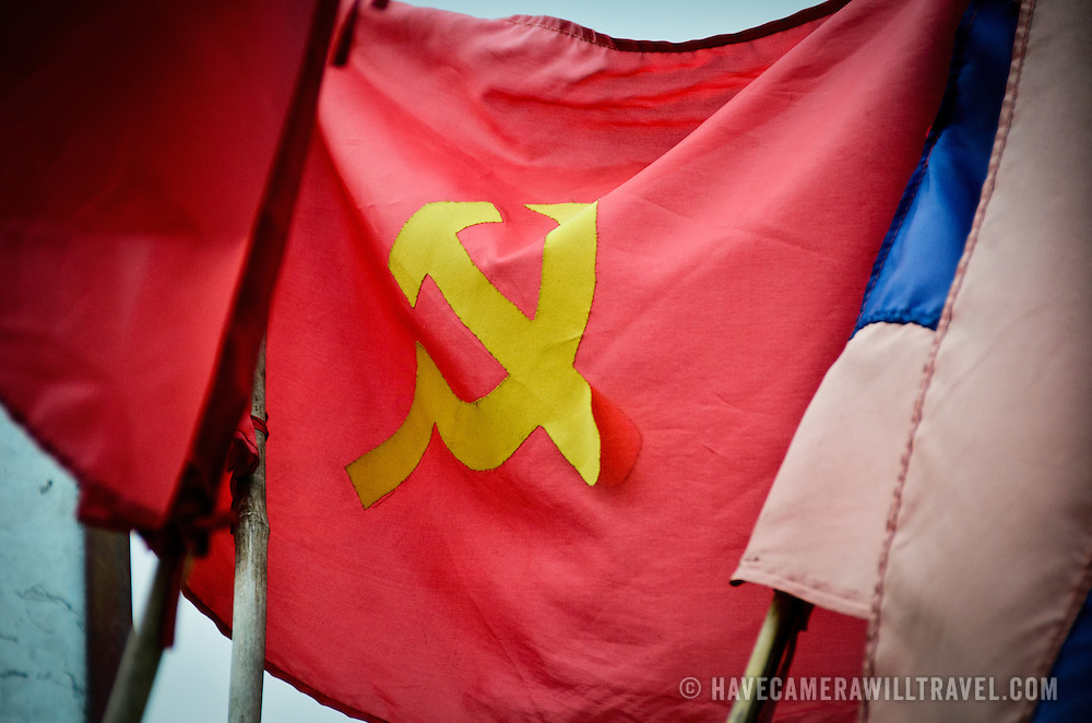 A Marxist hammer and sickle flag in disrepair in Luang Namtha, Laos.