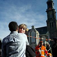 Nederland, Amsterdam , 27 april 2015.<br /> Vrijmarkt en plezier tijdens Koningsdag op NDSM terrein in Amsterdam Noord.<br /> Op de foto: De pont arriveert  beladen met Koningsdag feestvierders op het NDSM terrein in Amsterdam Noord.<br /> Foto:Jean-Pierre Jans